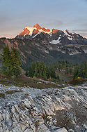 The last bit of sunset light shines on Mount Shuksan from the Artist Point to Huntoon Point trail Washington State's North Cascades Range. Photographed from Huntoon Point in the Mount Baker Wilderness. Mount Shuksan itself lies in North Cascades National Park.