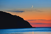 SHoreline along the Gulf of St. Lawrence at sunrise with crescent moon<br />Mont-Louis<br />Quebec<br />Canada