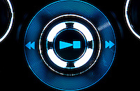 View of play, stop, symbol control of mpe player with blue light.