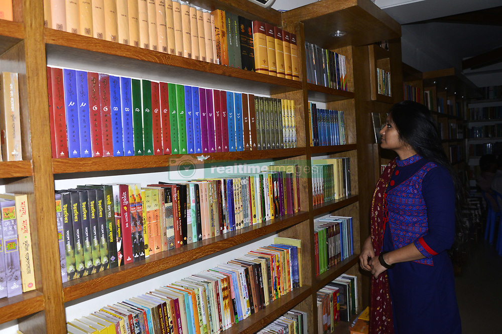 August 14, 2017 - Dhaka, Bangladesh - A Bangladeshi People reads and search Novel, Historical, Literature and others books for buy in a bookshop in Dhaka, Bangladesh, on August 14, 2017  (Credit Image: © Str/NurPhoto via ZUMA Press)