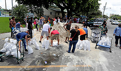 September 8, 2017 - Dania Beach, FL, USA - Residents line up at Frost Park in Dania Beach and fill up sandbags ahead of Hurricane Irma. Mike Stocker, South Florida Sun-Sentinel  (Credit Image: © Sun-Sentinel via ZUMA Wire)