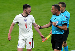 England's Declan Rice (left) speaks to the referee Artur Soraes Dias at half-time during the UEFA Euro 2020 Group D match at Wembley Stadium, London. Picture date: Tuesday June 22, 2021.