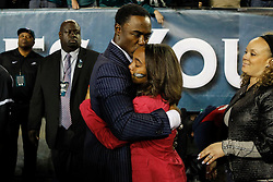 Former Philadelphia Eagle Brian Dawkins hugs his daughter during the half time ceremony to retire his jersey number as he retires from the NFL during the NFL football game between the New York Giants and the Philadelphia Eagles on Sunday, September 30th 2012 in Philadelphia. The Eagles won 19-17. (Photo by Brian Garfinkel)