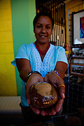 A vendor holds a coffee muffin at the Maricao Coffee Festival in Puerto Rico.