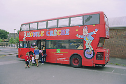 Parents and children getting onto playbus,