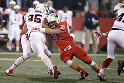 11 December 2015:  Bryce Holm(31) stops Gordon Collins. NCAA FCS Quarter Final Football Playoff game between Richmond Spiders and Illinois State Redbirds at Hancock Stadium in Normal IL (Photo by Alan Look)