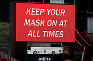 Scoreboard telling fans to keep your mask on at all times during the EFL Sky Bet League 1 match between Charlton Athletic and AFC Wimbledon at The Valley, London, England on 12 December 2020.