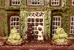 Two figures on a cake of Highgrove House gifted by Prince Charles (known as The Duke of Rothesay when in Scotland) during his visit to the Ayrshire Hospice in Ayr where he met patients and their families, staff and volunteers.
