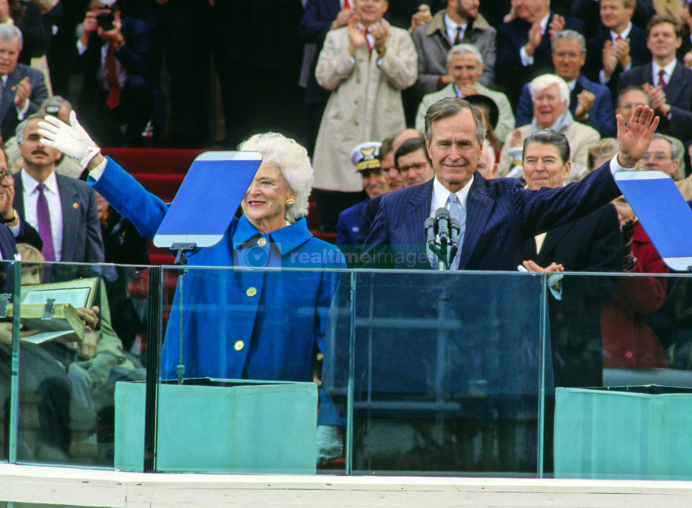 United States President George H.W. Bush and first lady Barbara Bush wave prior to his delivering the Inaugural Address after being sworn-in as 41st President of the United States at the US Capitol on January 20, 1989. Visible at right is former US President Ronald Reagan. Photo by Louis Jacobson / CNP /ABACAPRESS.COM