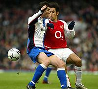 Photo. Chris Ratcliffe<br />Arsenal v Blackburn Rovers. FA Premiership. 14/12/2003<br />Brett Emerton and Robert Pires tussle at Highbury