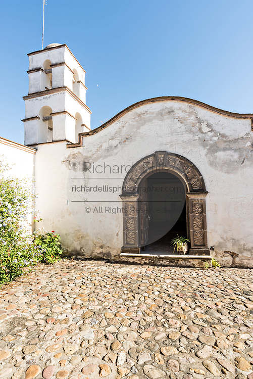 A restored home and gate in the semi ghost town of Mineral de Pozos, Guanajuato, Mexico. The town, once a major silver mining center was abandoned and left to ruin but has slowly comeback to life as a bohemian arts community.