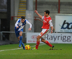 Bristol Rovers' Michael Smith avoids the tackle from Morecambe's Stewart Drummond - Photo mandatory by-line: Dougie Allward/JMP - Tel: Mobile: 07966 386802 14/12/2013 - SPORT - Football - Morecombe - Globe Arena - Morecombe v Bristol Rovers - Sky Bet League Two