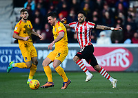 Northampton Town's David Buchanan under pressure from Lincoln City's Bruno Andrade<br /> <br /> Photographer Andrew Vaughan/CameraSport<br /> <br /> The EFL Sky Bet League Two - Lincoln City v Northampton Town - Saturday 9th February 2019 - Sincil Bank - Lincoln<br /> <br /> World Copyright © 2019 CameraSport. All rights reserved. 43 Linden Ave. Countesthorpe. Leicester. England. LE8 5PG - Tel: +44 (0) 116 277 4147 - admin@camerasport.com - www.camerasport.com