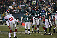 PHILADELPHIA - DECEMBER 9: David Akers #2 and Sav Rocca of Philadelphia Eagles and Corey Webster #23 of the New York Giants watch the field goal attampt in the last seconds of play during the game on December 9, 2007 at Lincoln Financial Field in Philadelphia, Pennsylvania. The Giants won 16-13.
