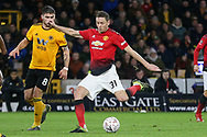 Manchester United Midfielder Nemanja Matic shoots at goal  during the The FA Cup match between Wolverhampton Wanderers and Manchester United at Molineux, Wolverhampton, England on 16 March 2019.