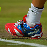 Andy Roddick of the United States wore flag-themed tennis shoes against Martin Klizan of Slovakia during second round men's singles competition at Wimbledon during the 2012 Summer Olympic Games in London, England, Monday, July 30, 2012. (David Eulitt/Kansas City Star/MCT)