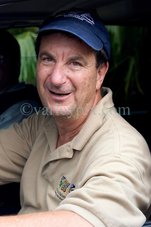 03 September 2005. New Orleans, Louisiana.  Post Hurricane Katrina.<br /> An exhausted looking Ron Forman, Director of Audubon Zoo, New Orleans talks briefly as he races about to try and save as many animals as he can.<br /> Photo Credit ©: Charlie Varley/varleypix.com