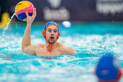 Kjeld Veenhuis of the Netherlands in action against Montenegro during the Olympic qualifying tournament. The Dutch water polo players are on the hunt for a starting ticket for the Olympic Games on February 19, 2021 in Rotterdam