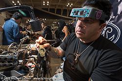 Bill Wall working on Jewelry in his Bill Wall Leather booth at the Mooneyes Yokohama Hot Rod & Custom Show. Yokohama, Japan. December 4, 2016.  Photography ©2016 Michael Lichter.