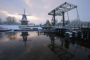 Windmill and bridge over the Reitdiep in Garnwerd during winter // Molen en brug over het Reitdiep, Garnwerd.