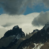 Clouds billow over the Horns of Paine in Torres del  Paine National Park in Patagonia, Chile.