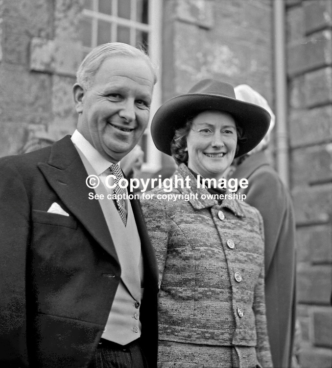 Ulster Unionist leader Brian Faulkner, and his wife, Lucy Faulkner, at the wedding in Co Fermanagh of Major Nigel Cowie and Juliana Brooke. Juliana is the daughter of Captain John Brooke and Mrs John Brooke. She is the granddaughter of Lord Brookeborough, a former prime minister of N Ireland. 197303020123j<br /> <br /> Copyright Image from Victor Patterson, Belfast, UK<br /> <br /> t: +44 28 9066 1296 (from Rep of Ireland 048 9066 1296)<br /> m: +44 7802 353836<br /> e: victorpattersonbelfast@gmail.com<br /> <br /> www.images4media.com<br /> <br /> Please see my full Terms and Conditions of Use at https://www.images4media.com/p/terms-conditions - it is IMPORTANT that you familiarise yourself with them.<br /> <br /> Images used online incur an additional cost. This cost should be agreed in writing in advance. Online images must be visibly watermarked i.e. © Victor Patterson or that of the named photographer within the body of the image. The original metadata must not be deleted from images used online.<br /> <br /> This image is only available for the use of the download recipient i.e. television station, newspaper, magazine, book publisher, etc, and must not be passed on to a third party. It is also downloaded on condition that each and every usage is notified within 7 days to victorpattersonbelfast@gmail.com.<br /> <br /> The right of Victor Patterson (or the named photographer) to be identified as the author is asserted in accordance with The Copyright Designs And Patents Act (1988). All moral rights are asserted.