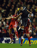 Photo: Paul Greenwood.<br />Liverpool v Manchester City. The Barclays Premiership. 25/11/2006. Liverpools Bolo Zenden, left, and Manchester City's Bernardo Corradi challenge each other in the air.