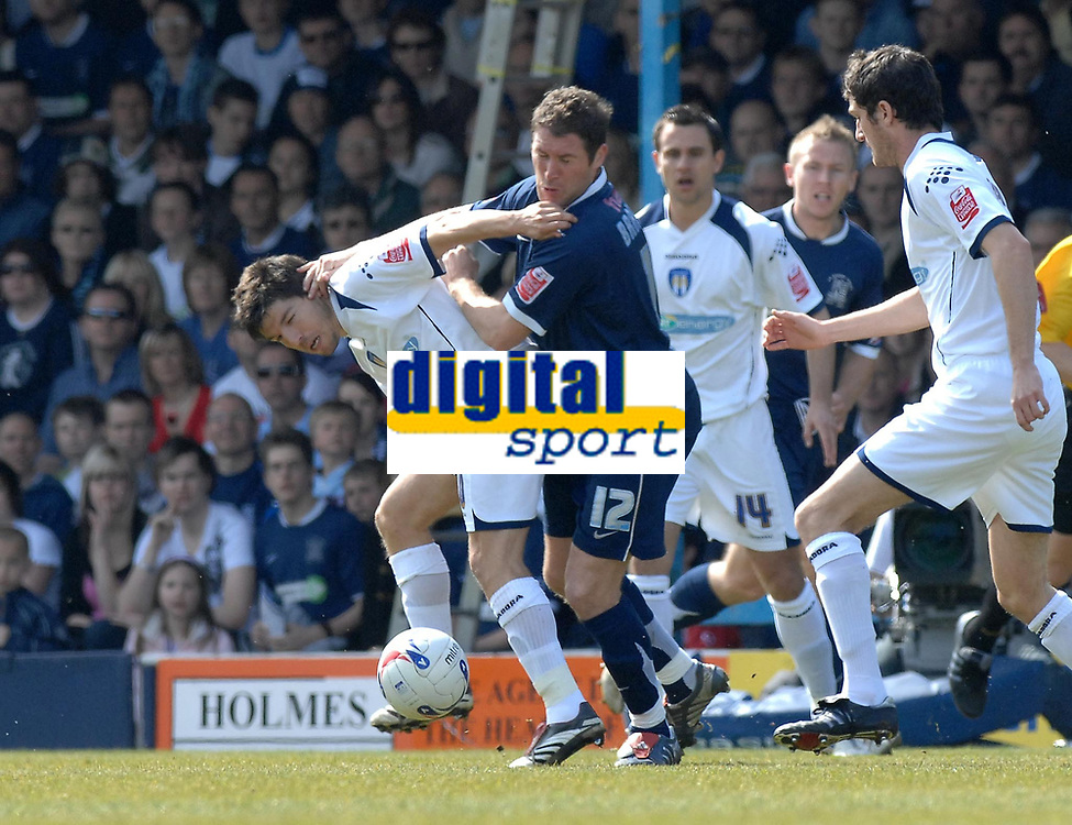 Photo: Ashley Pickering.<br /> Southend United v Colchester United. Coca Cola Championship. 06/04/2007.<br /> Lee Bradbury of Southend (blue) tangles with Kem Izzet of Colchester (L)