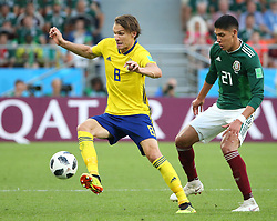 June 27, 2018 - Yekaterinburg, Russia - Edson Alvarez (R) of Mexico vies with Albin Ekdal of Sweden during the 2018 FIFA World Cup Group F match between Mexico and Sweden in Yekaterinburg, Russia, June 27, 2018. (Credit Image: © Li Ming/Xinhua via ZUMA Wire)
