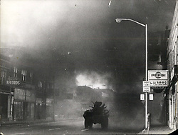 Jul. 26, 1967 - Detroit Race Riots: Lone tank manned by troops rumbles toward flames of a fresh fire in last evening's violence along shattered remains of 12th St. Credit: The Detroit News. (Credit Image: © Keystone Press Agency/Keystone USA via ZUMAPRESS.com)