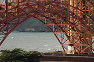 Lighthouse and steel arch at Fort Point, Golden Gate National Recreation Area, San Francisco, California