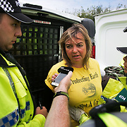 13 local activists locked themselves in specially made arm tubes to block the entrance to Quadrilla's drill site in New Preston Road, July 03 2017, Lancashire, United Kingdom. Councillor Miranda Cox being arrested afte 10 hours in a lock-on. The 13 activists included 3 councillors; Julie Brickles, Miranda Cox and Gina Dowding and Nick Danby, Martin Porter, Jeanette Porter,  Michelle Martin, Louise Robinson,<br /> Alana McCullough, Nick Sheldrick, Cath Robinson, Barbara Cookson, Dan Huxley-Blyth. The blockade is a repsonse to the emmidiate drilling for shale gas, fracking, by the fracking company Quadrilla. Lancashire voted against permitting fracking but was over ruled by the conservative central Government. All the activists have been active in the struggle against fracking for years but this is their first direct action of peacefull protesting. Fracking is a highly contested way of extracting gas, it is risky to extract and damaging to the environment and is banned in parts of Europe . Lancashire has in the past experienced earth quakes blamed on fracking.