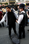 Police using their powers of stop and search during the general strike march in central London. At this point the police were arresting / searching and detaining people they suspected were part of anarchist groups determined to create havoc in London on the day.