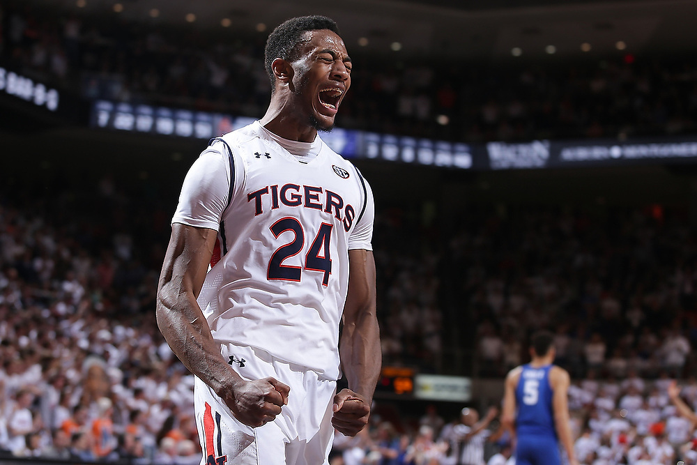 Auburn's Anfernee McLemore (24) celebrates during the second half of the game against Kentucky. <br /> No. 10 Auburn Tigers vs. Kentucky Wildcats at Auburn Arena in Auburn, Ala. on Wednesday, Feb. 14, 2018.<br /> Zach Bland/Auburn Athletics