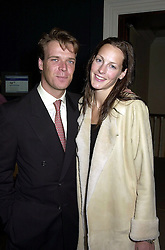 MR JOEL CADBURY and the HON.CAMILLA ASTOR, at a party in London on 25th September 2000.OHH 141