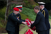 British Ambassador, Paul Madden collects a wreath of poppies to lay at the Cross of Sacrifice during the  Remembrance Sunday ceremony at the Hodogaya, Commonwealth War Graves Cemetery in Hodogaya, Yokohama, Kanagawa, Japan. Sunday November 12th 2017. The Hodagaya Cemetery holds the remains of more than 1500 servicemen and women, from the Commonwealth but also from Holland and the United States, who died as prisoners of war or during the Allied occupation of Japan. Each year officials from the British and Commonwealth embassies, the British Legion and the British Chamber of Commerce honour the dead at a ceremony in this beautiful cemetery.