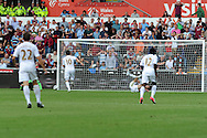 Swansea city's Michu (on ground) scores his sides 2nd goal past West Ham keeper Jussi Jaaskelainen (22) .Barclays Premier league, Swansea city  v West Ham Utd at the Liberty Stadium in Swansea, South Wales  on Saturday 25th August 2012. pic by Andrew Orchard, Andrew Orchard sports photography,