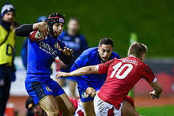 Cristian Lai of Italy evades the tackle of Sam Costelow of Wales <br /> <br /> Photographer Craig Thomas/Replay Images<br /> <br /> U20 Six Nations - Wales v Italy  - Friday 31st January 2020 - Stadiwm Zip World (Parc Eirias) - Colwyn Bay<br /> <br /> World Copyright © Replay Images . All rights reserved. info@replayimages.co.uk - http://replayimages.co.uk