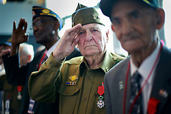 06 June 2014. The National WWII Museum, New Orleans, Lousiana. <br /> WWII veteran Pfc Horace Calhoun, (middle) Company K, 116th Infantry, 3rd Battalion is presented with the French Legion of Honor medal by the French Consul General Jean Claude Brunet. <br /> Photo; Charlie Varley/varleypix.com
