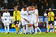 Peterborough United midfielder Joe Ward (15) scores and celebrates with team mates 1-0 during the EFL Sky Bet League 1 match between Burton Albion and Peterborough United at the Pirelli Stadium, Burton upon Trent, England on 27 October 2018.