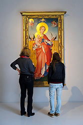 """Cologne, Germany, Jan. 2012 - PICTURED: Patrons view Stefan Lochner's """"Madonna with the Violet"""" at the Kolumba Museum in Cologne Germany...Its hard to say what makes more impact: the Kolumba museums vertiginous mix of ancient religious and modern secular artworks, or its astounding, vintage-2007 building from the Pritzker-winning Swiss architect Peter Zumthor. Shift your gaze from an oversize, late-12th-century carved ivory crucifix to a neighboring untitled sculpture by the great Joseph Beuys, then take in the spires of the Cologne Dom cathedral, artfully framed in a nearby floor-to-ceiling window (Kolumbastrasse 4; 49-221-933-193-32; kolumba.de). (Photo © Jock Fistick)"""
