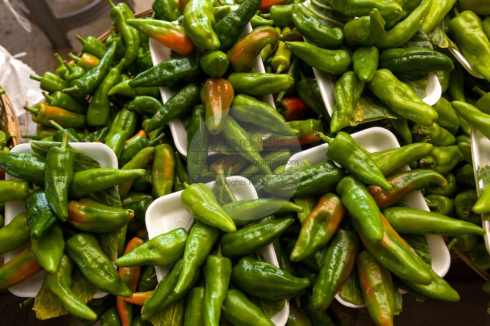 Cubanelles green peppers at the Sunday market in Tlacolula de Matamoros, Mexico. The regional street market draws thousands of sellers and shoppers from throughout the Valles Centrales de Oaxaca.