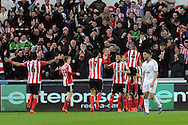 Southampton's players celebrate after Shane Long (hidden) scores their 1st goal. Barclays Premier league match, Swansea city v Southampton at the Liberty Stadium in Swansea, South Wales on Saturday 13th February 2016.<br /> pic by  Carl Robertson, Andrew Orchard sports photography.