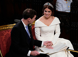 Princess Eugenie and her husband Jack Brooksbank, during their wedding ceremony at St George's Chapel in Windsor Castle.