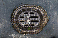 Maintenance Hole- and Drain Covers of Wirral by Colin McPherson, 2020-21.<br /> <br /> A maintenance hole (manhole) cover manufactured by James Pendleton & Co. Liverpool. In Victorian times the company was based at the Dale Street Foundry, but it is no longer in existence.