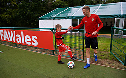 CARDIFF, WALES - Monday, September 3, 2018: Wales' Andy King meets a young supporter during a training session at the Vale Resort ahead of the UEFA Nations League Group Stage League B Group 4 match between Wales and Republic of Ireland. (Pic by David Rawcliffe/Propaganda)