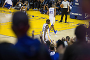 Fans cheer as Golden State Warriors forward Kevin Durant (35) takes a seat on the bench against the Oklahoma City Thunder at Oracle Arena in Oakland, Calif., on November 3, 2016. (Stan Olszewski/Special to S.F. Examiner)