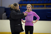 Moscow, Russia, 23/02/2004..AZLK Moskvich chief coach Viktor Kudriatsev training skaters on the club's main ice rink. Kudriatsev coaching Julia Soldatova, the subject of a dispute between Russia and Belarus, both of whom want her to skate for them..