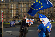 As Prime Minister Theresa May prepares to sell her Brexit deal ahead of five days of debate and eventual vote in parliament, both pro-EU Remainers and Brexiteers argue outside the House of Commons, on 4th December 2018, in London, England. This week will be a vital step for Mays Premiership and the UKs Brexit status.