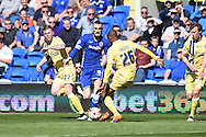 Cardiff city's Scott Malone © gets in between Millwall's Aiden O'Brien (l) and Nadjim Abdou (26). Skybet football league championship, Cardiff city v Millwall at the Cardiff city stadium in Cardiff, South Wales on Saturday 18th April 2015<br /> pic by Andrew Orchard, Andrew Orchard sports photography.